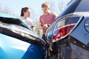 Two people observing a car accident
